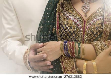 Indian bride and Groom holding hands after getting married - stock photo