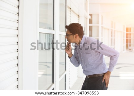 indian business male checking properties - stock photo
