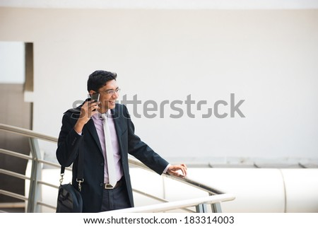 indian business male in a conversation with a phone - stock photo