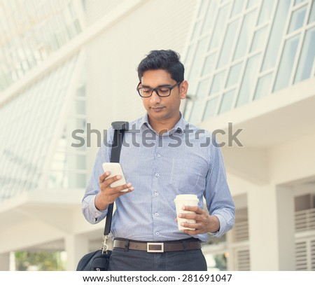 indian business male on a phone outdoor - stock photo