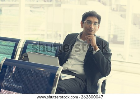 indian business male waiting at the airport - stock photo