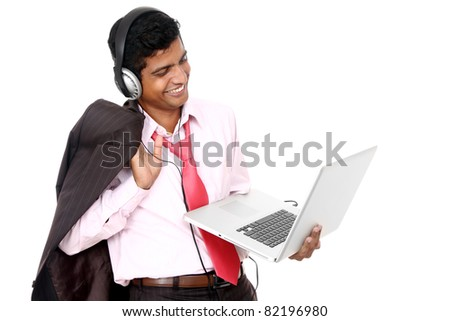 Indian business man hearing music isolated on white. - stock photo
