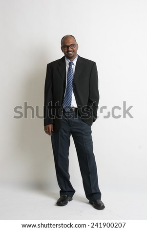 Indian business man smiling on formal wear full body - stock photo