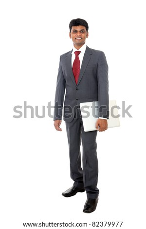 Indian business man standing with laptop isolated on white. - stock photo