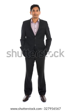 indian business man with coat standing - stock photo