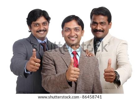 Indian business people posing to the camera - stock photo