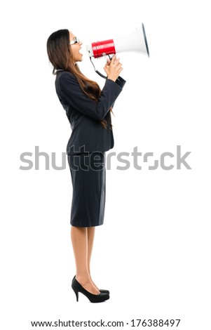 Indian business woman holding megaphone loudspeak shouting announcement leadership - stock photo