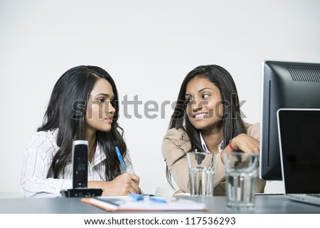Indian business woman in office working together. - stock photo