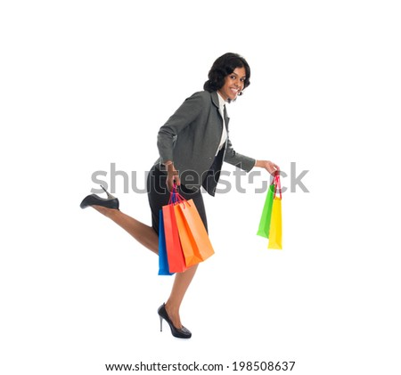 indian business woman running while shopping  - stock photo