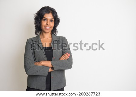 indian business woman smiling with plain background - stock photo