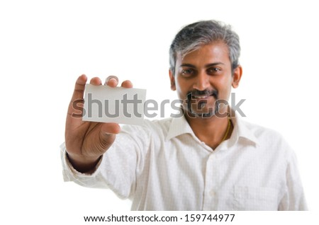 Indian businessman holding business card, focus on hand over white background - stock photo