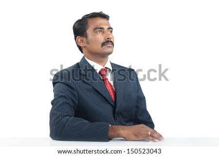 Indian Businessman Looking up - stock photo