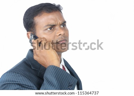 Indian businessman using a mobile phone - stock photo