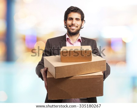 indian businessman with cardboard boxes - stock photo