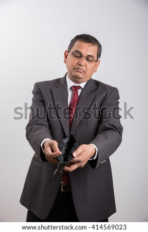 indian businessman with empty purse, asian businessman with no money in purse for saving, businessman showing empty money purse over white background, indian businessman and bankruptcy concept - stock photo