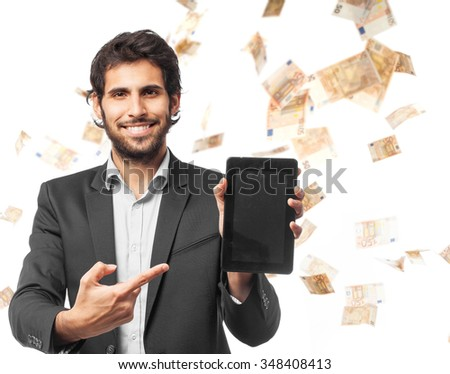 indian businessman with touch screen pad - stock photo