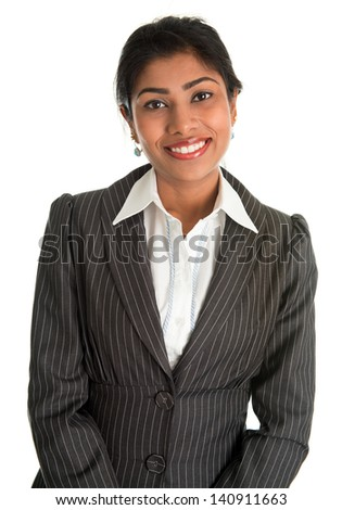 Indian businesswoman in business suit smiling looking at camera, standing isolated on white background. Asian female model. - stock photo