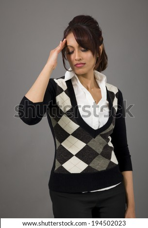 Indian businesswoman suffering from headache - stock photo