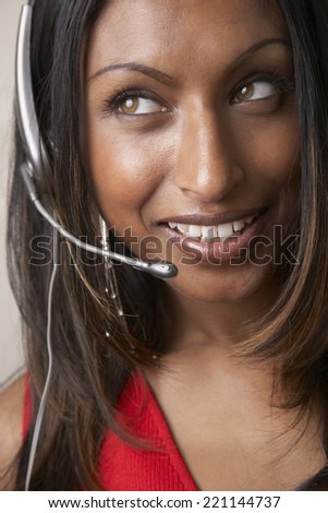 Indian businesswoman wearing headset - stock photo
