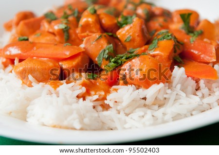 Indian butter chicken sauce with rice and sliced carrots - stock photo