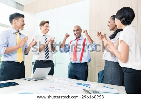 Indian CEO reporting success in business meeting - stock photo