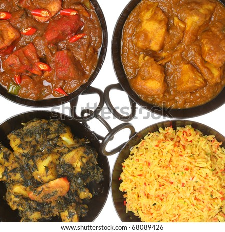 Indian chicken and vegetable curries with rice - stock photo
