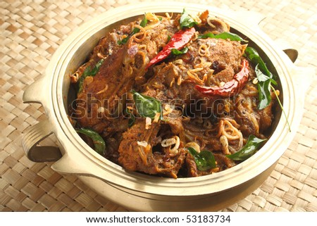 Indian chicken curry served in a traditional way - stock photo