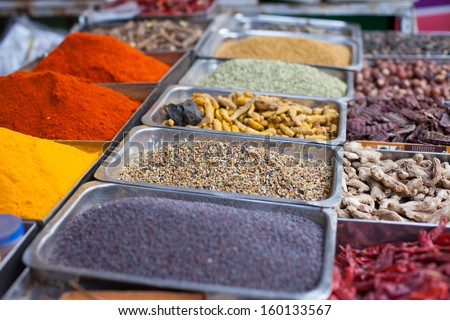 Indian colored spices at local market in Goa, India  - stock photo
