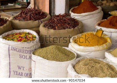 Indian colorful  spices on sale in local market. - stock photo