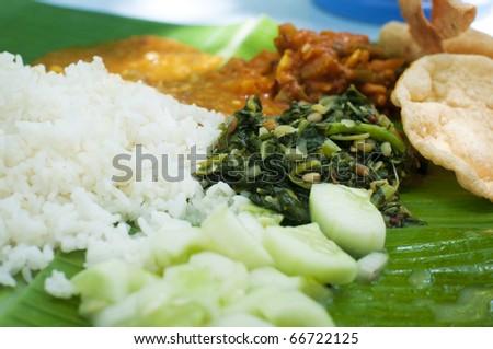 Indian cuisine banana leaf rice - stock photo