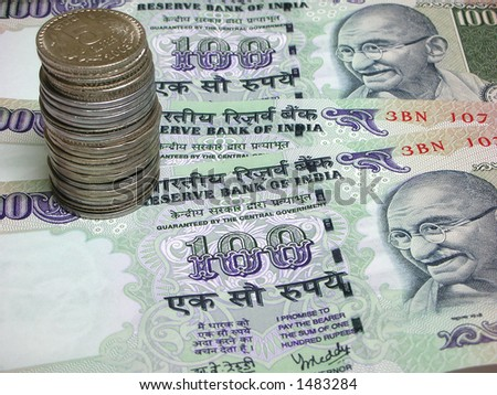 Indian Currency - Three one Hundred Rupee Notes / bills and a coin stack - stock photo