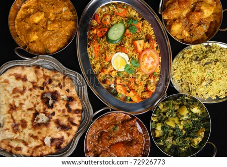 Indian curries with rice and naan. - stock photo