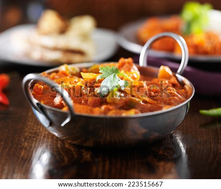 indian curry - chicken vindaloo in balti dish - stock photo