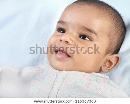Indian Cute Baby Looking Happy - stock photo