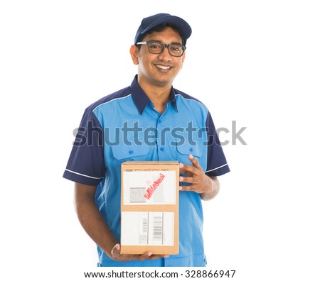 indian delivery man in blue uniform - stock photo