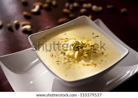 Indian dessert Rice pudding in bowl  - stock photo