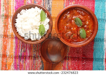 Indian Dish Rice & Red kidney beans (Rajma) in Wooden Bowls - stock photo