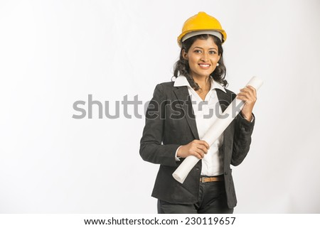 Indian engineer girl hold a blueprint and smile on white background  - stock photo