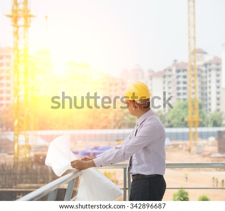 indian engineer on construction background - stock photo