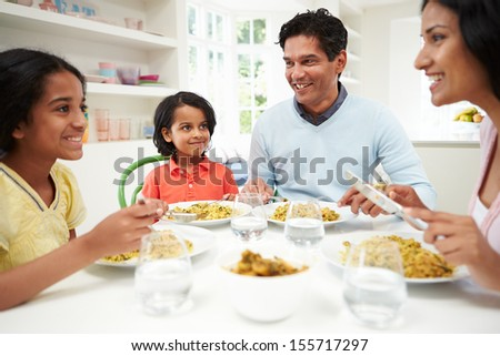 Indian Family Eating Meal At Home - stock photo
