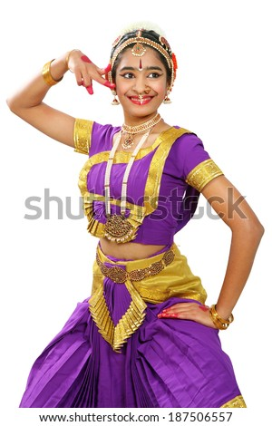 Indian female performing Bharathanatyam doing the action of  describing the eyes  in violet  color costumes. - stock photo