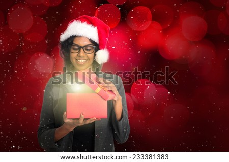 indian female with christmas present - stock photo