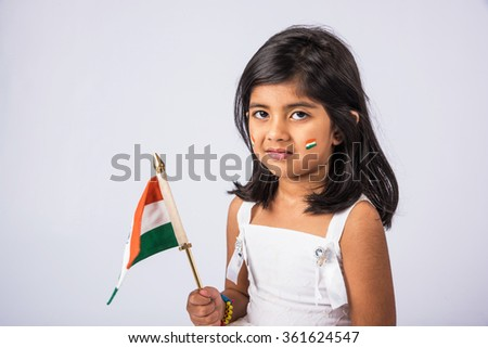 indian flag and cute little indian girl, 4 year indian girl with tri colour on face, india flag and girl, girl holding indian flag, indian independence day, indian republic day, isolated on white - stock photo