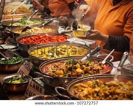 Indian food at London market - stock photo