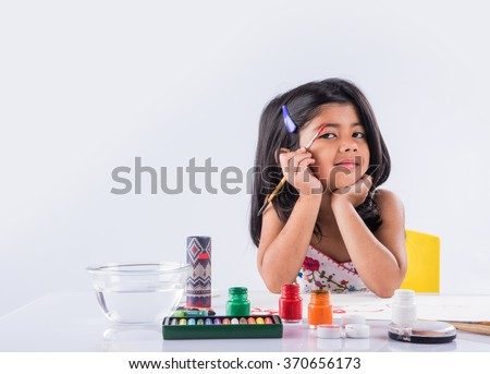 indian girl drawing, indian girl painting,asian girl colouring, paint brush and indian girl - stock photo
