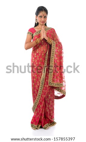 Indian girl in a greeting pose, traditional sari costume, full length standing isolated on white background - stock photo