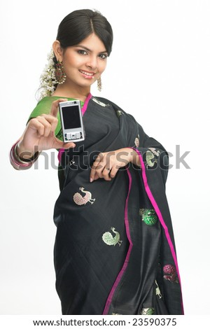 Indian girl in sari showing the mobile - stock photo