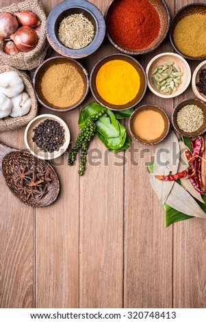 indian herbs in the wood bowl  - stock photo