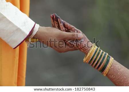 indian hindu bride and groom performing wedding rituals - stock photo