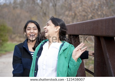 Indian loving mother and daughter in outdoors - stock photo